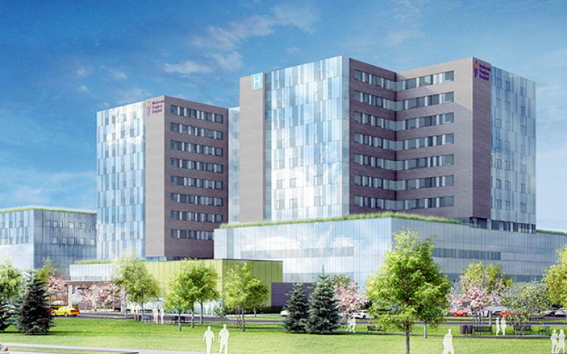 3D rendering of a multi storey hospital with green fields
