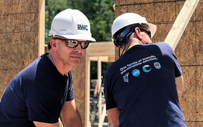 Sean McClenaghan, CEO Americas and Andrew Johnson, CFO Americas taking part in our Habitat for Humanity project.